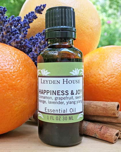 Photo of Happiness and Joy essential oil blend from Leyden House. Comes in an amber glass bottle.