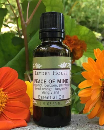 Photo of Peace of Mind Essential Oil blend in an amber one ounce bottle.