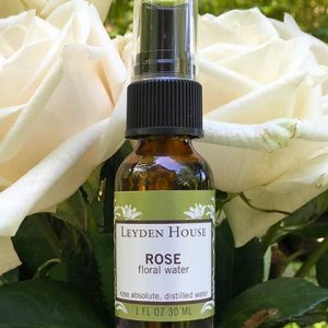 Photo of Rose Floral Water in an amber 1 oz bottle.