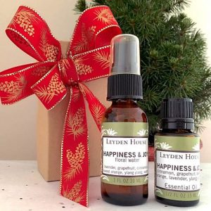 Photo of Leyden House Happiness and Joy gift set, which contains a 1 oz happiness and joy floral water and a 1/2 oz happiness and joy essential oil blend.