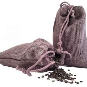 Photo of Lavender buds in a lavender colored burlap bag. 2 oz of lavender buds